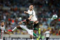 Alan Santos (top) of Coritiba vies with Wendel of Fluminense during the 2017 Brazilian Serie A 33rd round match at the Maracana Stadium, in Rio de Janeiro, Brazil, on Nov. 9, 2017.