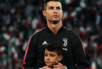 Cristiano Ronaldo of Juventus is accompanied by his son Cris Jr onto the field of play for the Serie A match at Allianz Stadium, Turin. Picture date: 19th May 2019.