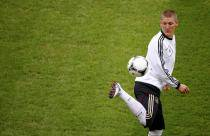 Schweinsteiger, midfielder of Germany's national soccer team juggles the ball during a practice session of his team at the stadium in Warsaw